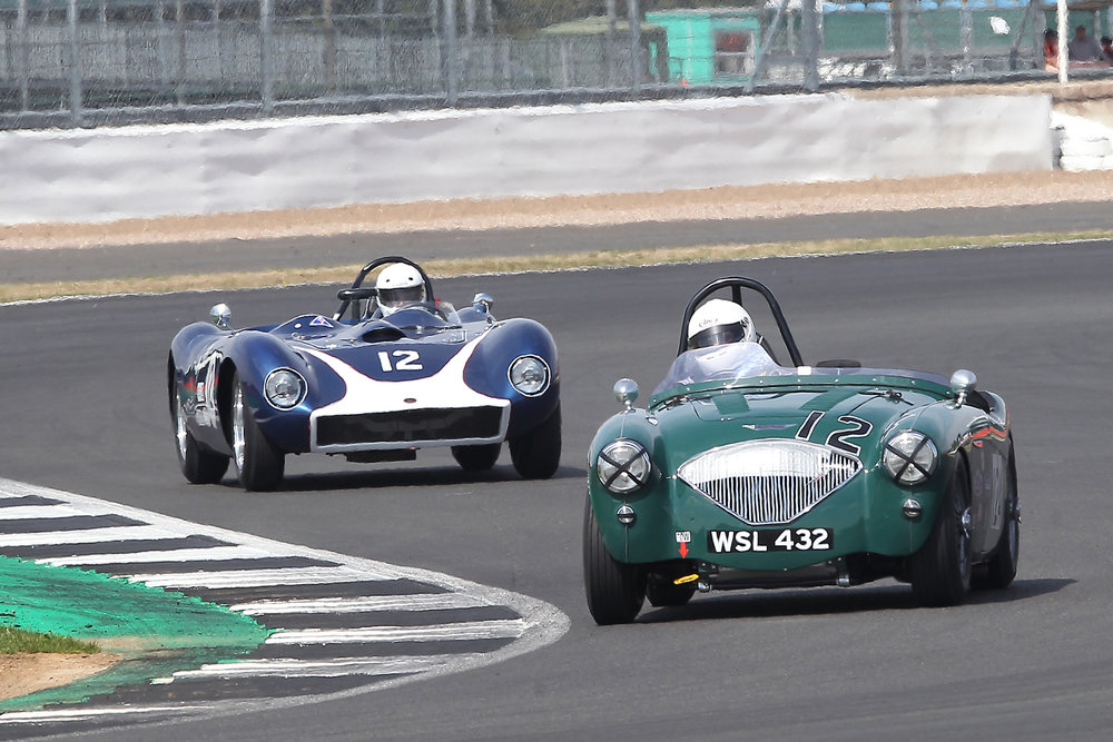 Jim Campbell fights off the close attention of Richard Tyzack's rare V8 Kellison J4R. Photo - Mick Walker