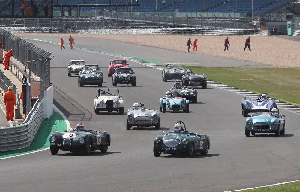 A wonderfully eclectic mix of 1950s sports cars get off the line as the marshals disperse to take up their positions               Photo - Mick Walker