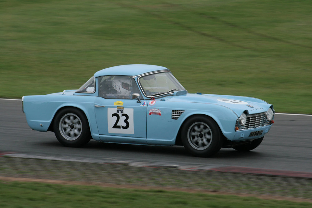 Michael Hunter assumed the lead in his TR4, once Brian Arculus had pitted and only lost it again to Brian once he too had pitted.  Photo - John Turner