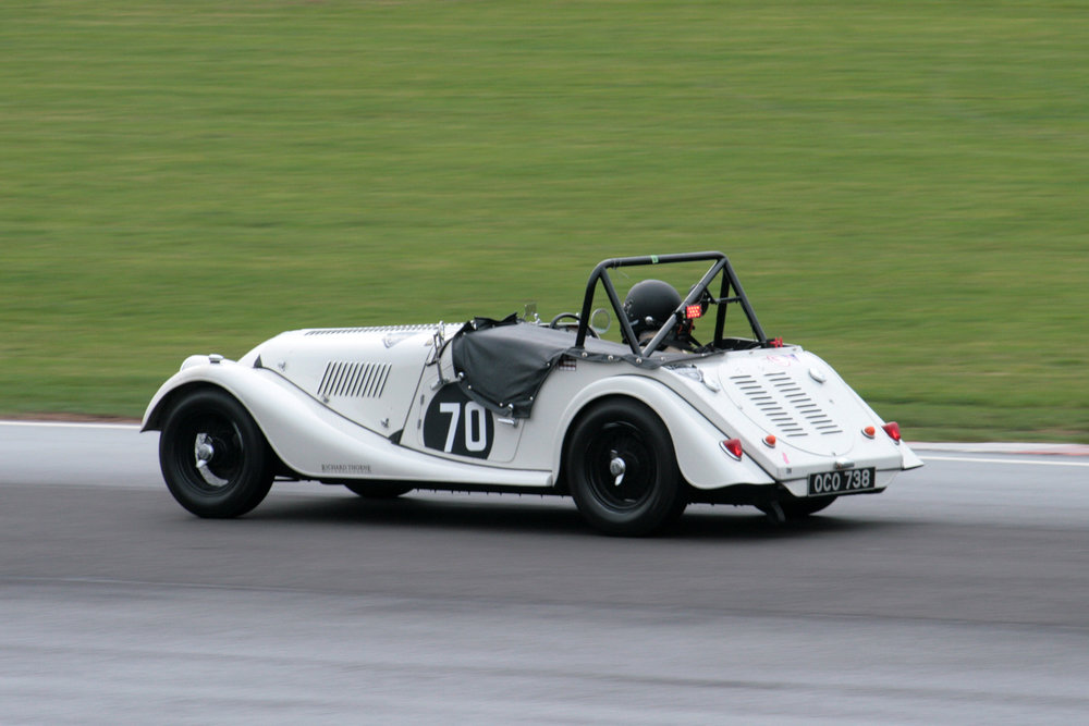 Alan House in the Morgan Plus 4. Note there is a drying line appearing on a still damp track  Photo - John Turner
