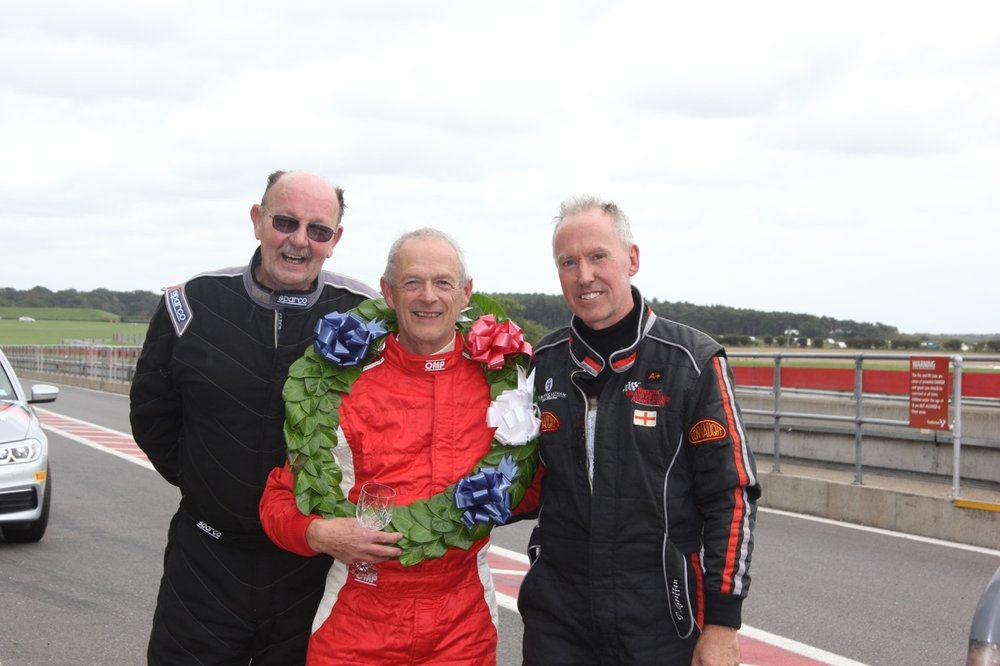 The winner, Brian Arculus, flanked by Jim Campbell (left - 3rd) and Paul Griffin (Right - 2nd)  Photo - Pat Arculus, Tripos Media