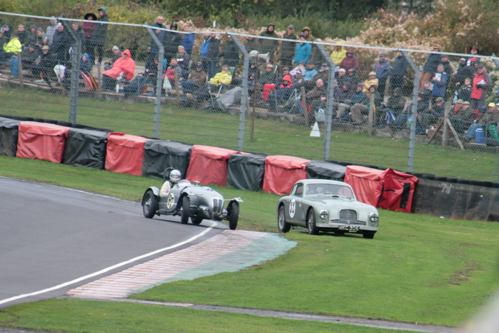 Mark Campbell takes avoiding action as he runs his Aston DB2 onto the grass whilst Ned Spieker get the Frazer Nash pointing the right way,,following a spin.  Photo - John Turner