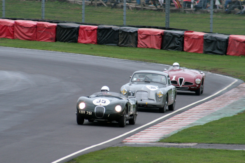 Great 3 way battle for 6th between David Brazell (Jaguar C-type), Tim Stamper (Aston Martin DB2/4) & Christopher Mann (Alfa Romeo Disco Volante), only ended when Chris had an off, damaging both ends of the Alfa . The C type was ahead of the Aston by 1.7 seconds at the end of 30 minutes racing  Photo - John Turner
