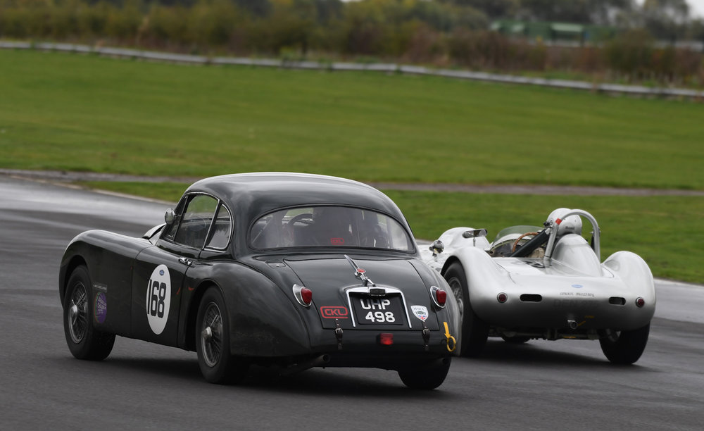 …… and succeeds. The Lister Bristol takes 2nd from the Jaguar XK150 on the penultimate lap  Photo - Jeff Bloxham