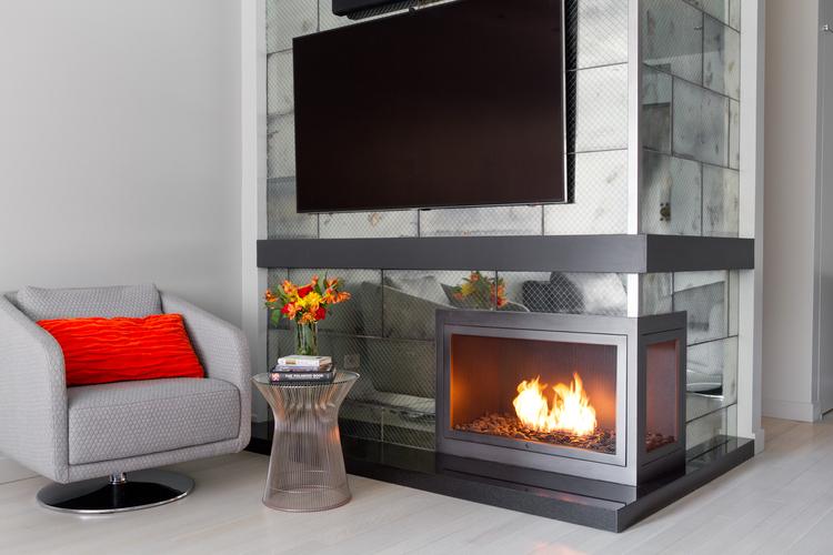 Corner HearthCabinet Ventless Fireplace, finished in custom pewter powder coated steel |Designer: Rick Trabucco