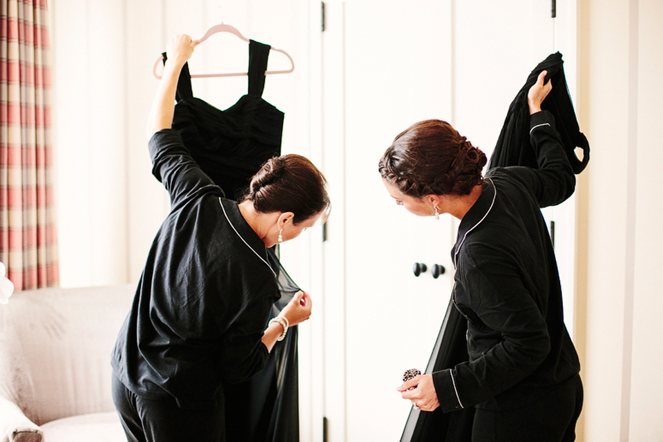 The bridesmaids get their dresses ready before the ceremony.