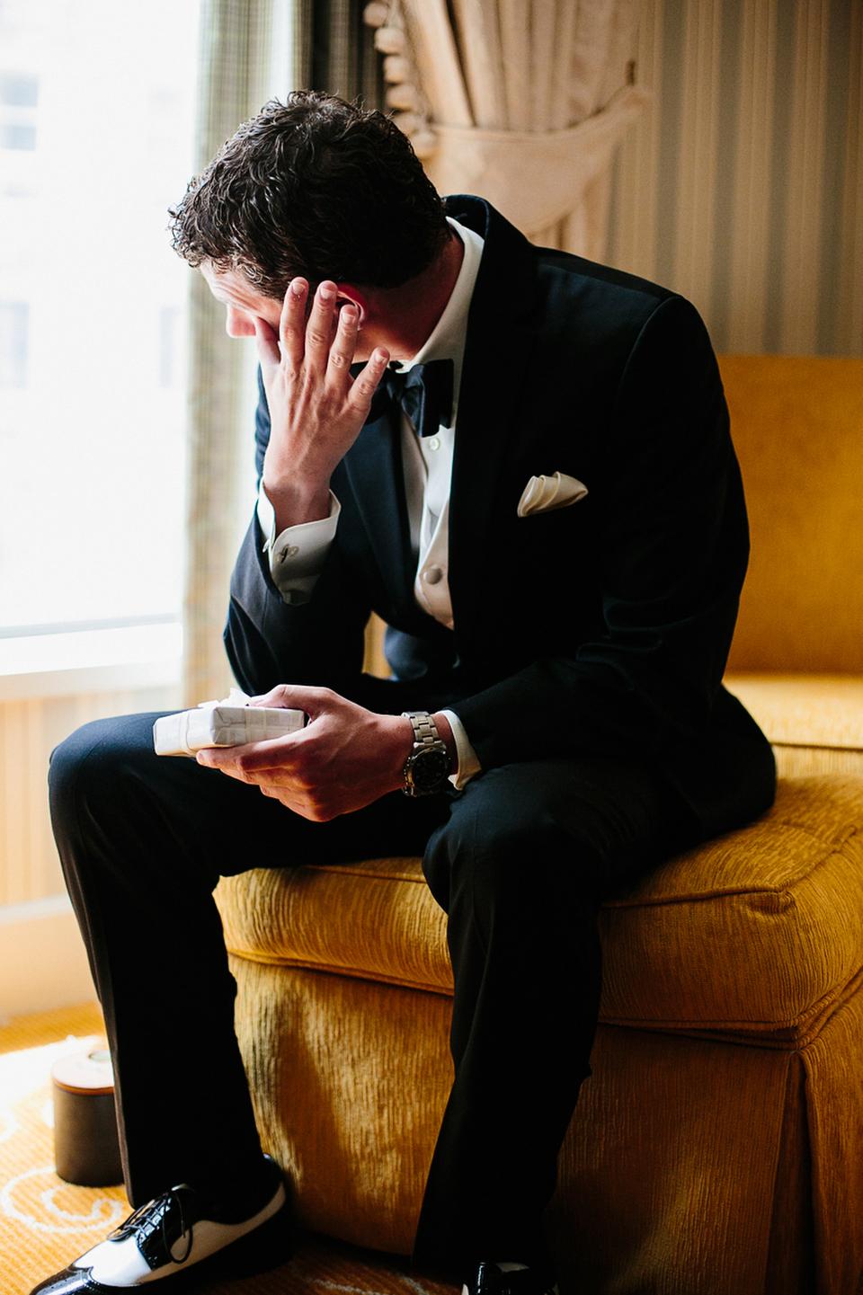 Portrait of an emotional groom as he prepares to meet his bride.