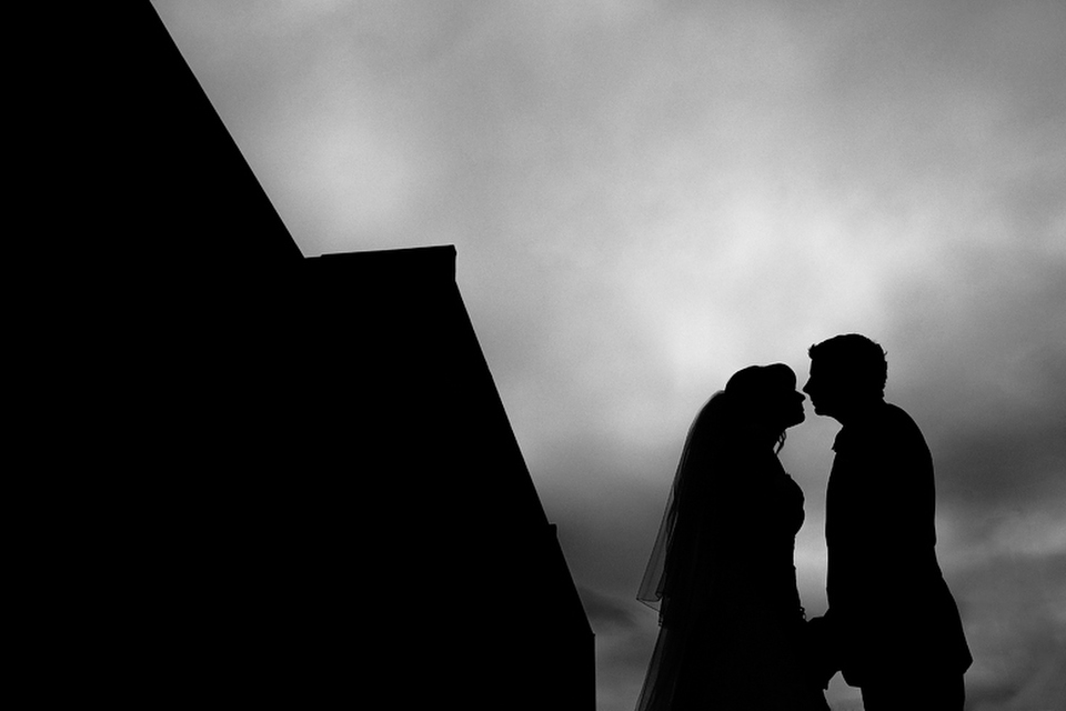 Black and white wedding portrait silhouette of the bride and groom.