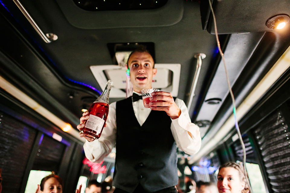 A groomsmen proposes a toast on the way to the ceremony.