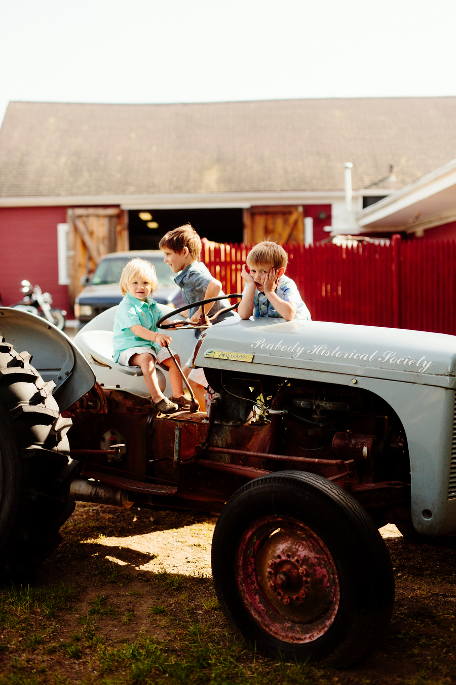 kids playing on a tractor