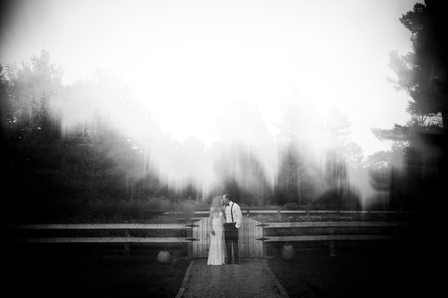 Bride and Groom on the grounds of the inn at essex vermont