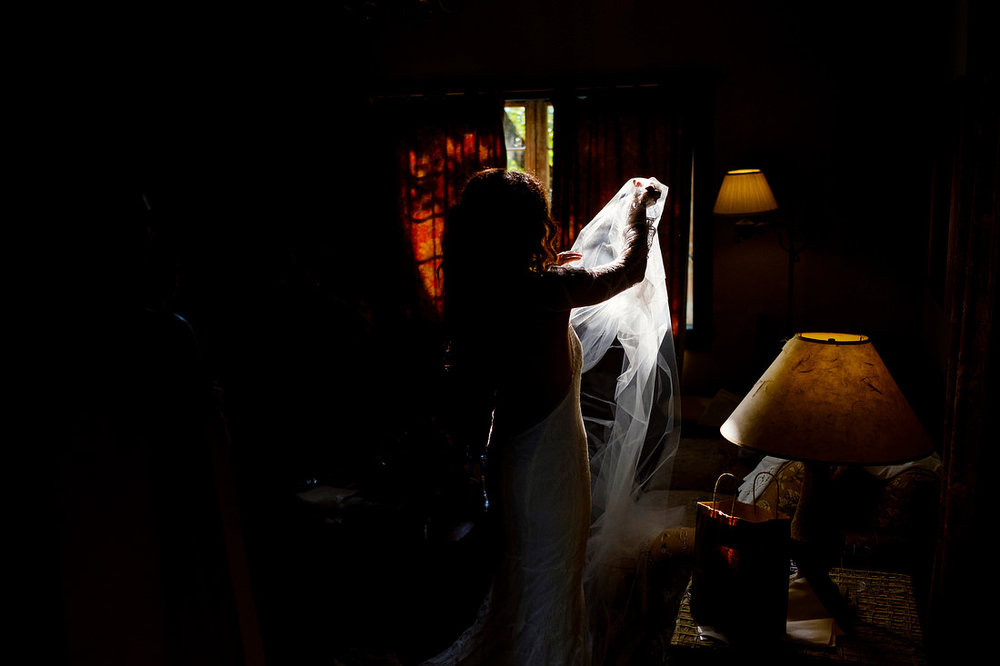 bride prepping with her veil at the gedney farm