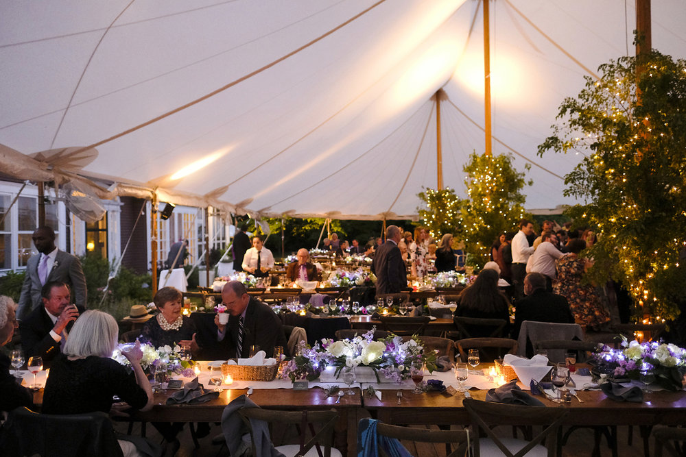 Guests enjoy this tented reception at summer wedding in Western Massachusetts.