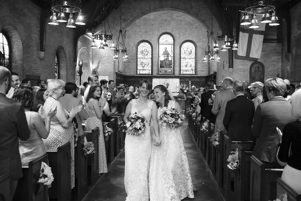 newlywed brides recess down the aisle after wedding in stockbridge in western ], ma.