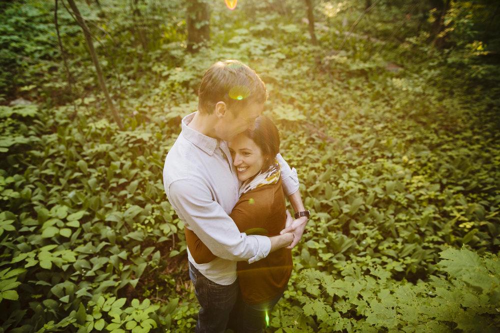 happy couple in the woods at habitat wildlife sanctuary in belmont, ma