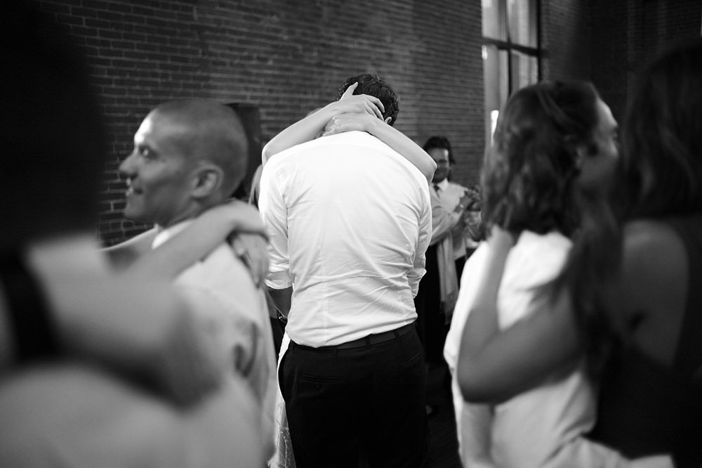 guests embrace during a slow dance at the charles river museum in waltham