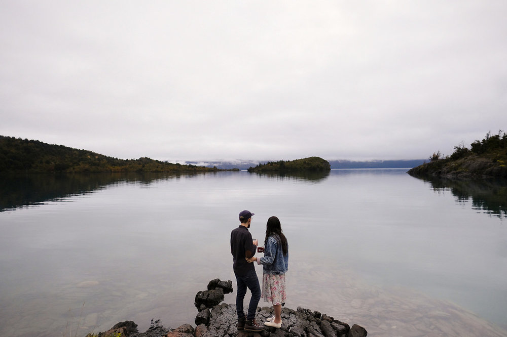 couple gazes out over water during the wedding elopement in patagonia chile