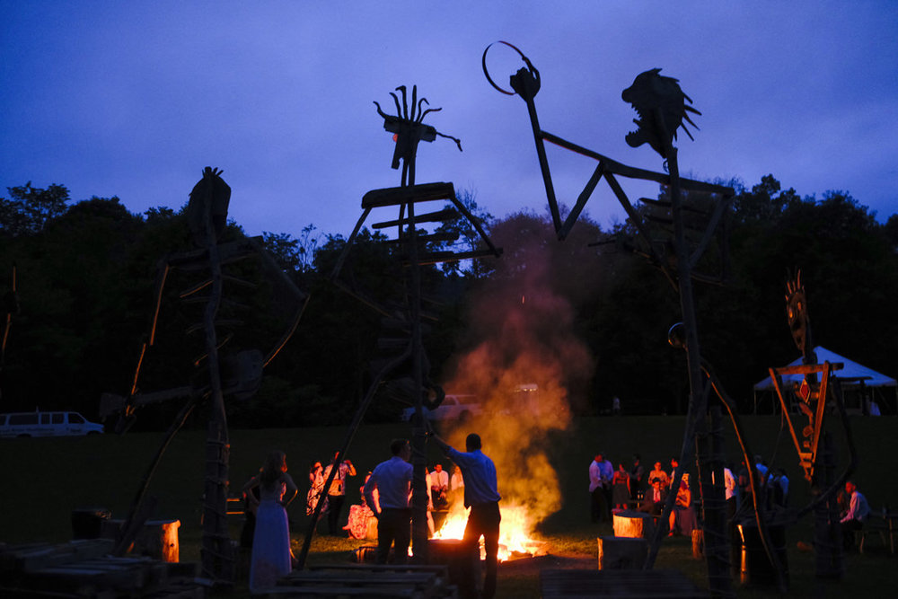 giant sculptures with bonfires at dusk at path of life sculpture garden wedding