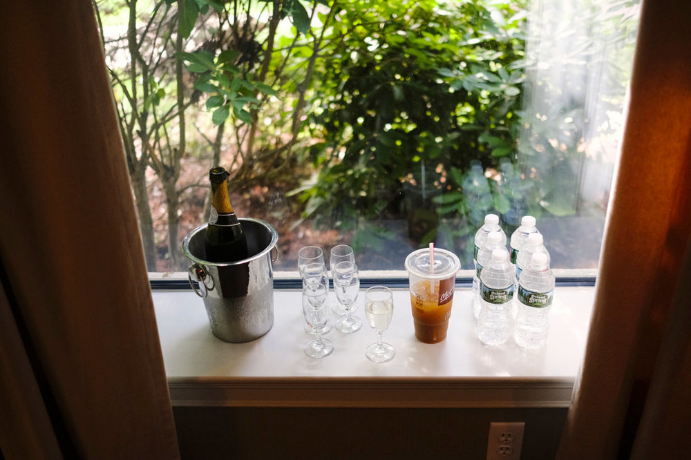 photograph of drinks on windowsill during bridal prep at south shore wedding