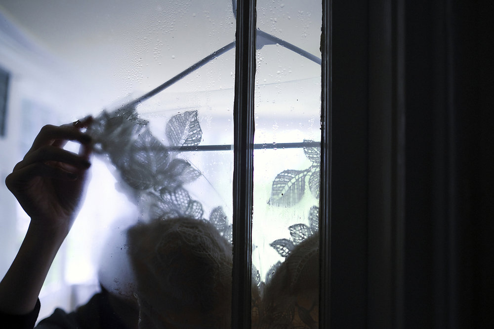 wedding dress details through window during bridal prep in western massachusetts