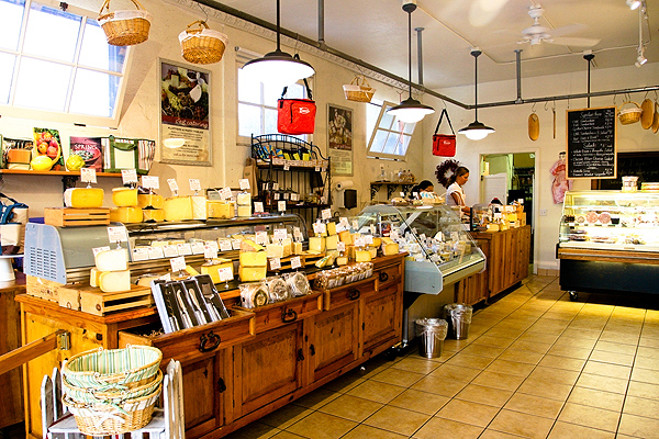 THE EARLY YEARS…  C'est Cheese began in a storefront that was 850 square feet and pretty much looked liked the pic above from 2003 - 2013.