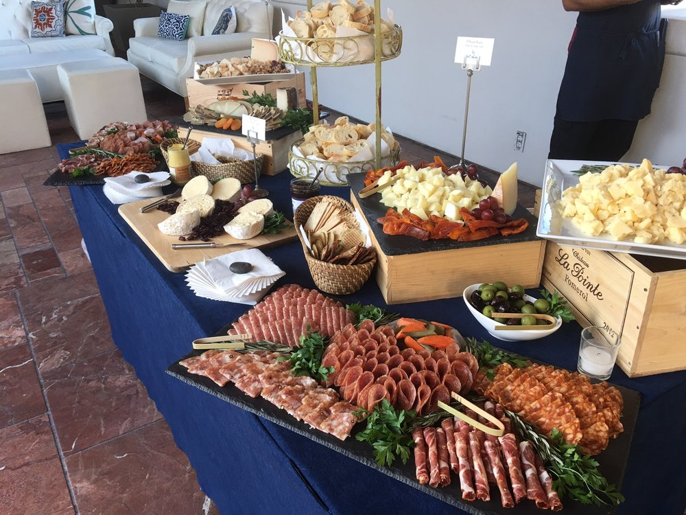 C'EST CHEESE CATERING  C'est Cheese Catering grew organically over the years starting with just cheese platters to now offering full service cheese and charcuterie tables as shown above in addition to a great selection of party, lunch and dessert platters.