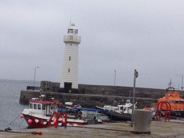 Donaghadee Famous Limestone Lighthouse -  on the night of 11th January 1836, a fixed light shone at the end of the south pier for the first time. It has been regularly painted white for about a century, the first in Ireland to be electrified.