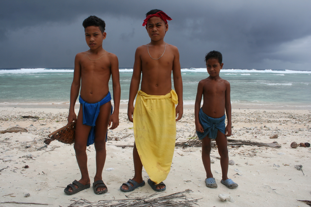 Colorful loincloths among the boys of Ifalik, with an approaching storm in the background.