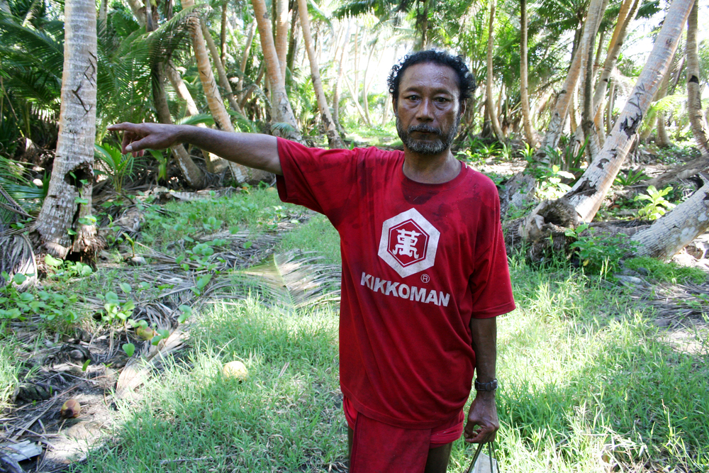 In December of 2008 a particularly strong series of tides, known as a king tide, rolled across parts of Ulithi, damaging large portions of the taro crop. This man is pointing to the area that was hardest hit.