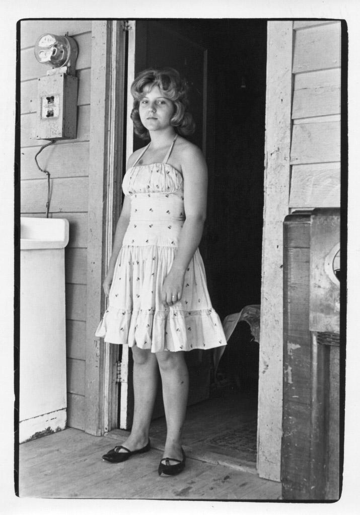 Woman wearing a dress, standing in a doorway, 1964.©Duke University David M. Rubenstein Rare Book & Manuscript Library