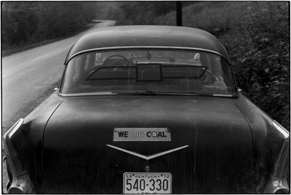 "Rear of car with Leslie County Kentucky license plate and bumper sticker reading ""We dig coal"", 1972. © Duke University David M. Rubenstein Rare Book & Manuscript Library"