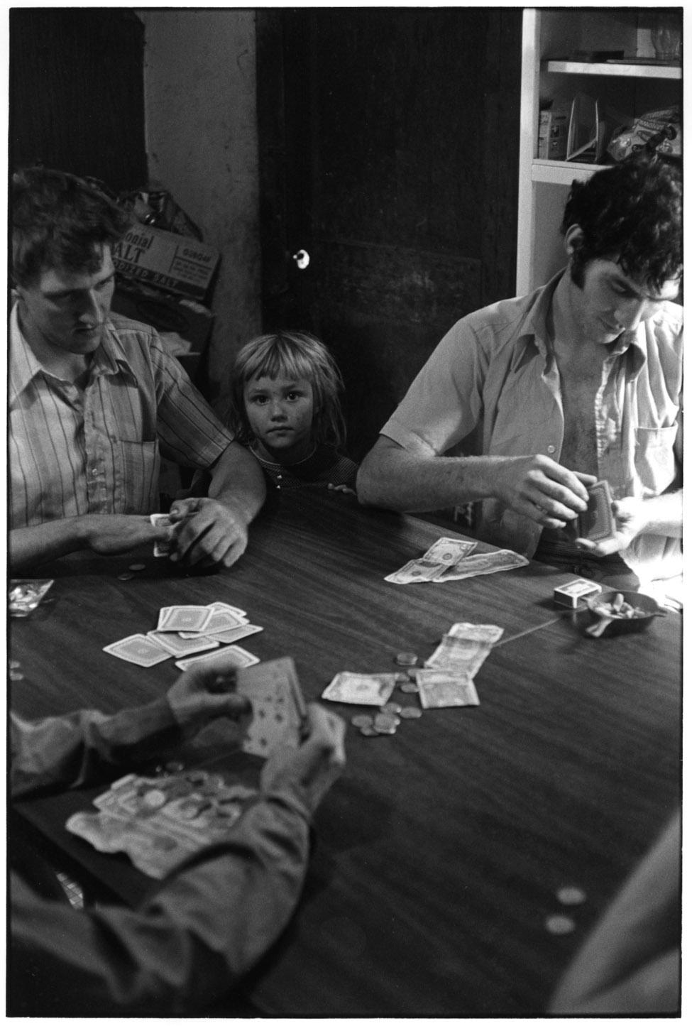 Poker game; little girl looking at camera, 1972©Duke University David M. Rubenstein Rare Book & Manuscript Library