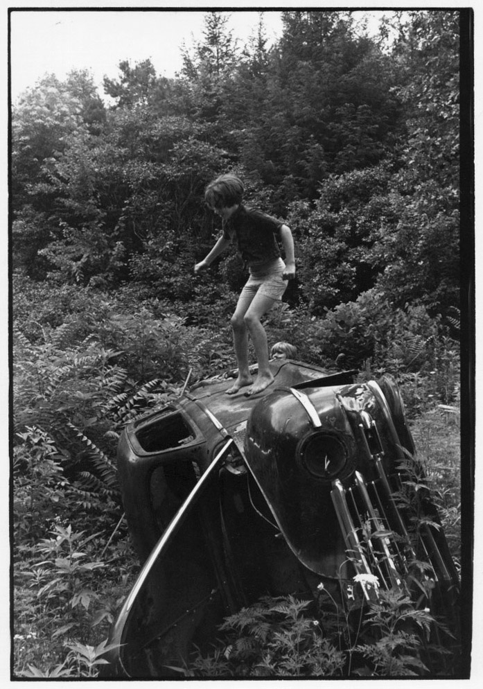 Girl jumping on truck laying on its side, 1964. © Duke University David M. Rubenstein Rare Book & Manuscript Library