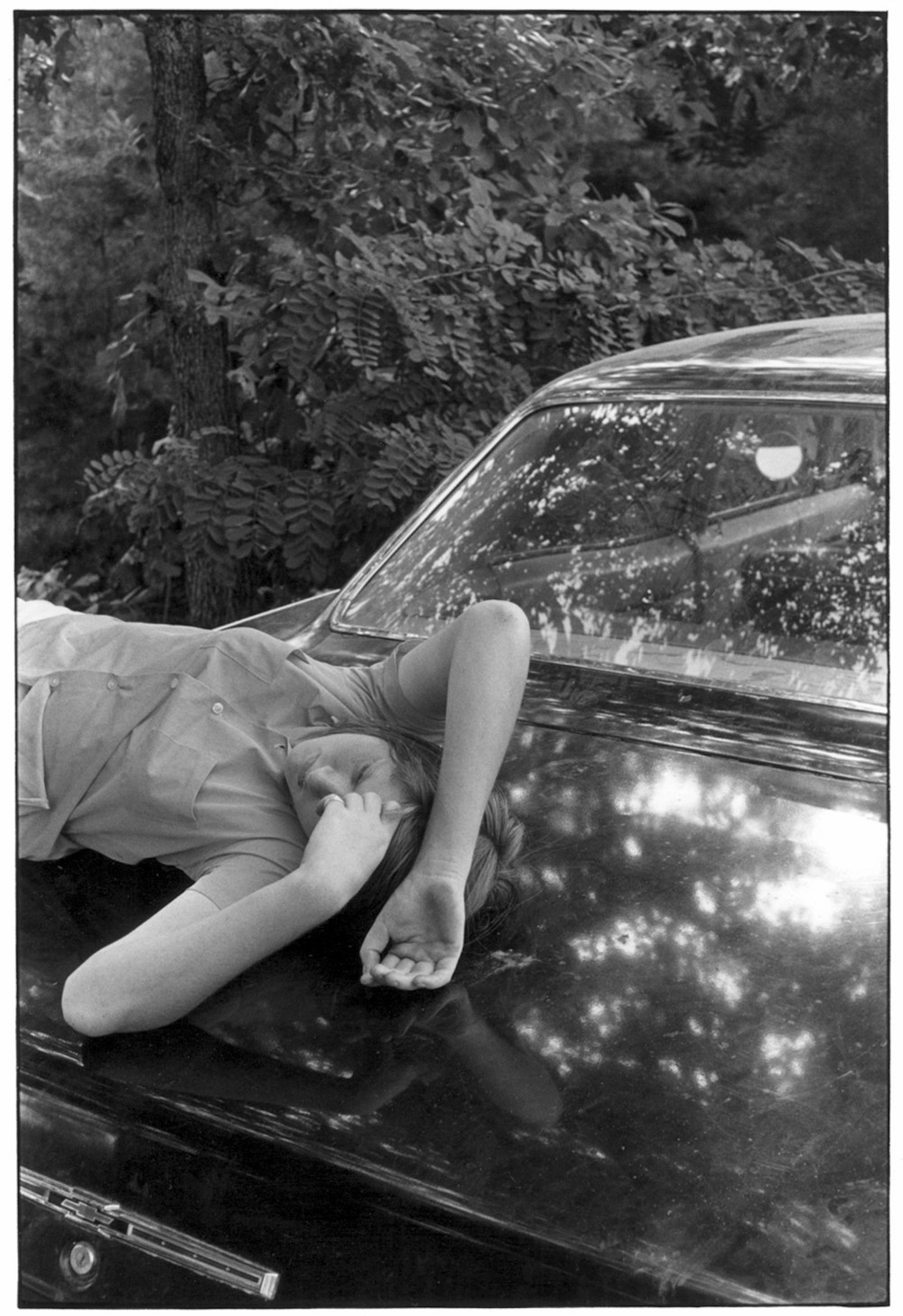 Girl lying on trunk of a car, 1972.©Duke University David M. Rubenstein Rare Book & Manuscript Library