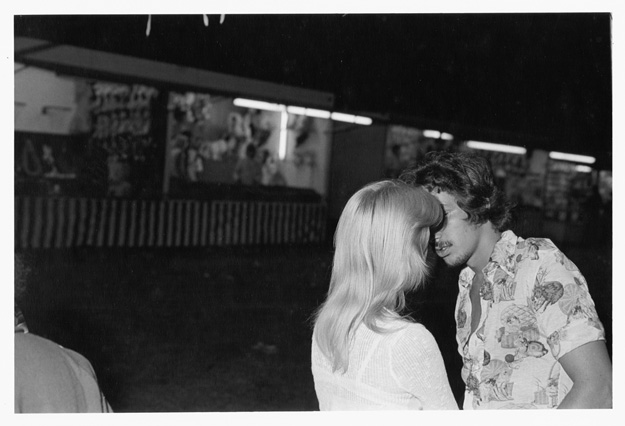 Boy and girl on midway, Decatur County Fair, 1977