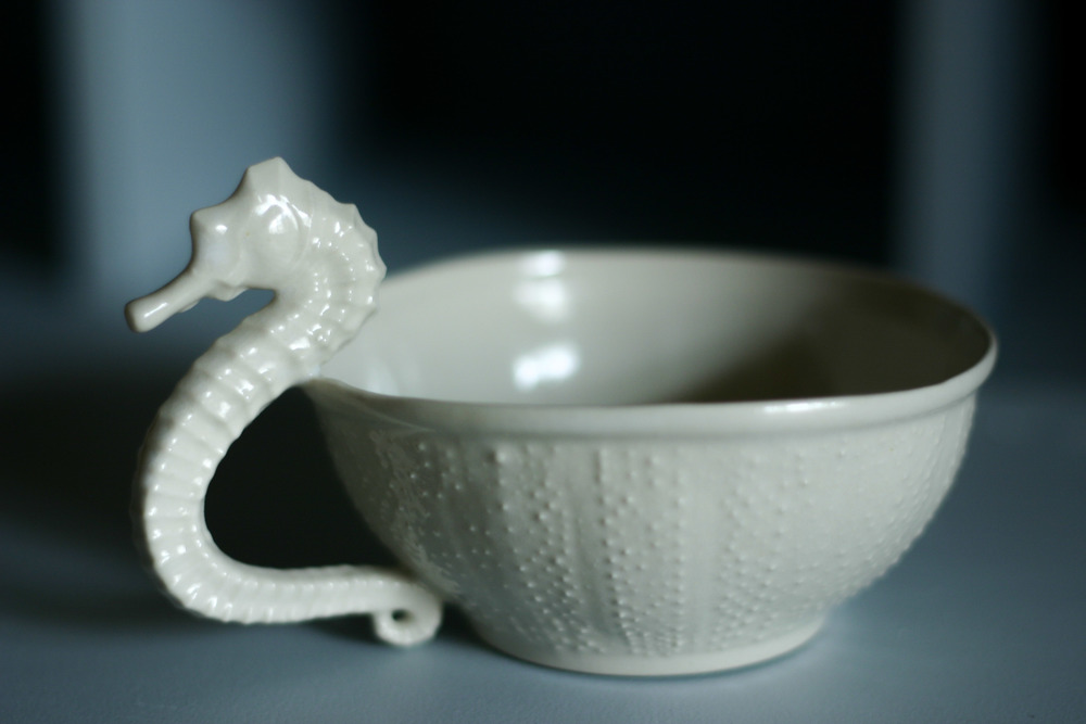 White porcelain teacup  on blue background