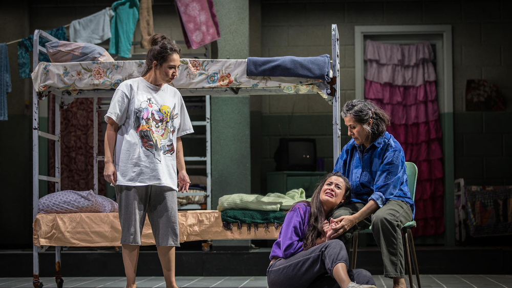 "Heather Velazquez as Maikelyn/Eva/Paramilitary, Stephanie Andrea Barron as Yolanda and Socorro Santiago as Ciliana in ""Another Word for Beauty"" by Jose Rivera, directed by Steve Cosson at Goodman Theatre (January 16 – February 21, 2016)."