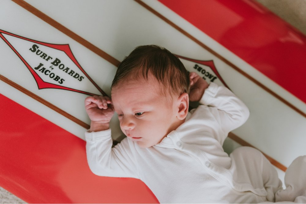 Picture-Of-Newborn-On-Custom-Surf-Board-During-Newborn-Photo-Session