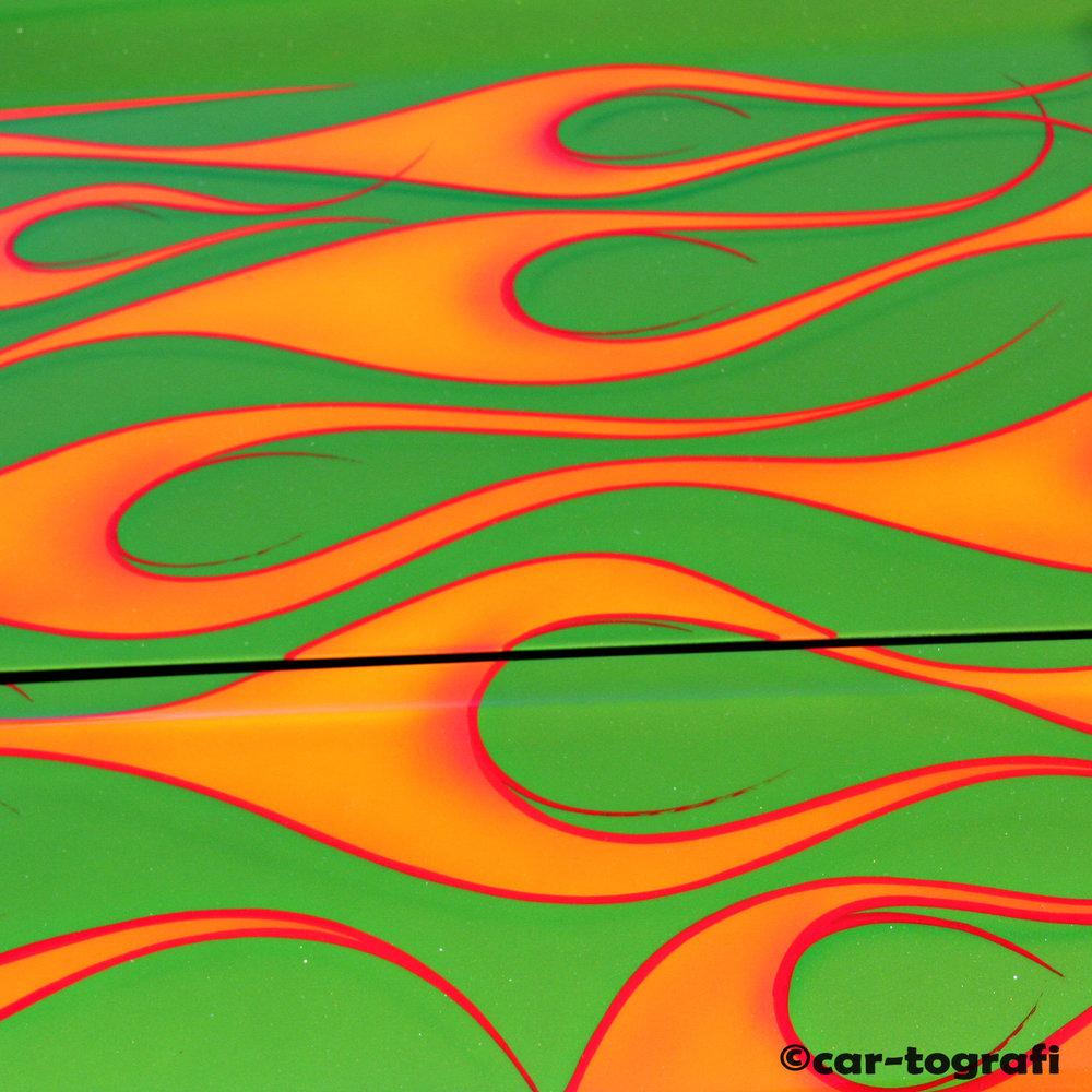 Green back orange flames