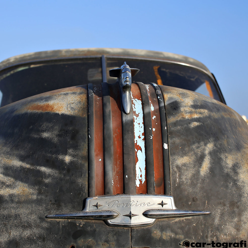 The Pontiac Hood Mascot car-tografi front and center