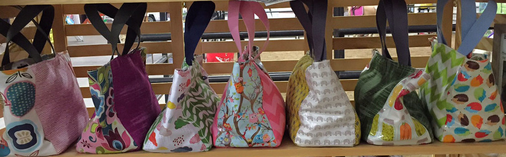 We've got some new Bobbin@5280 lunch bags in to coordinate with your favorite sandwich bag patterns.  Each one is a unique creation--get them while they last!