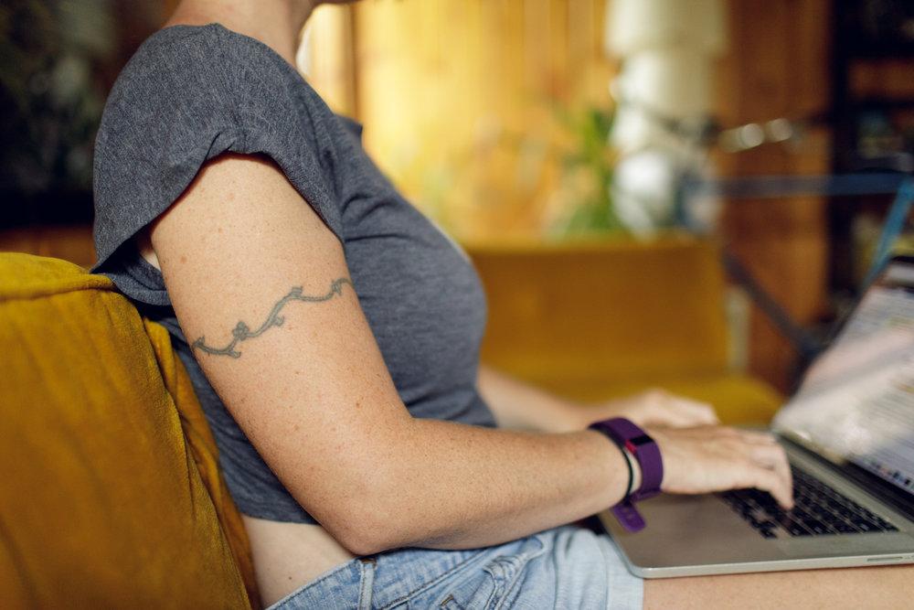 Woman working on MacBook laptop