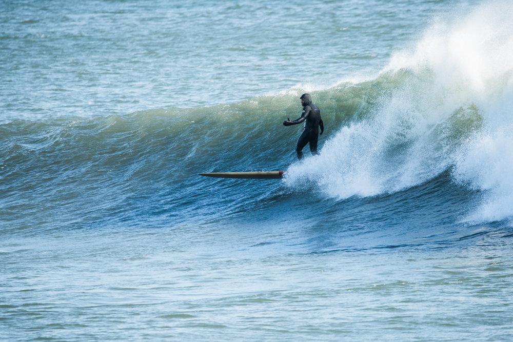 man surfing in Narragansett, RI