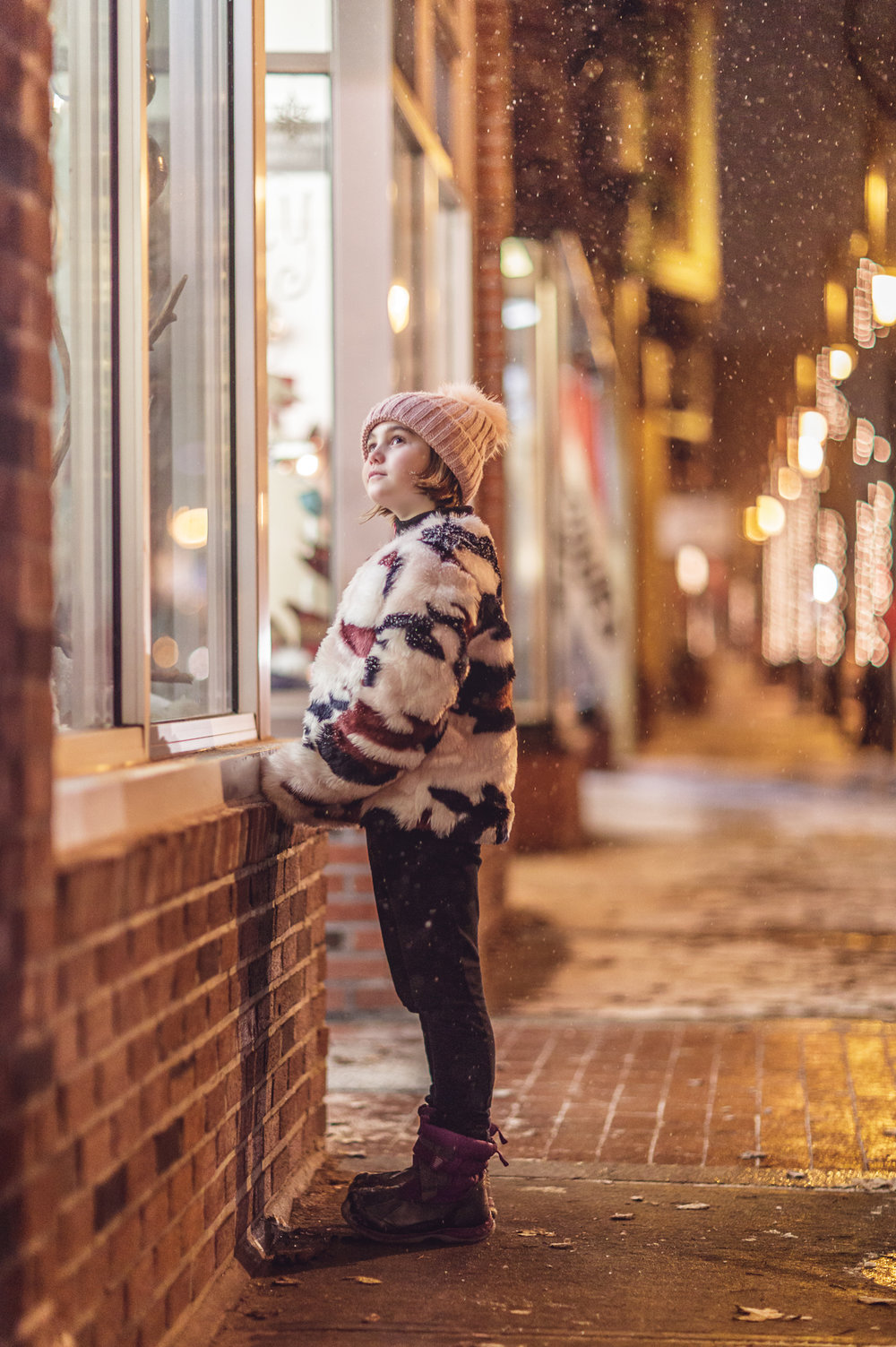 girl on Main st. in Wakefield, RI in the snow