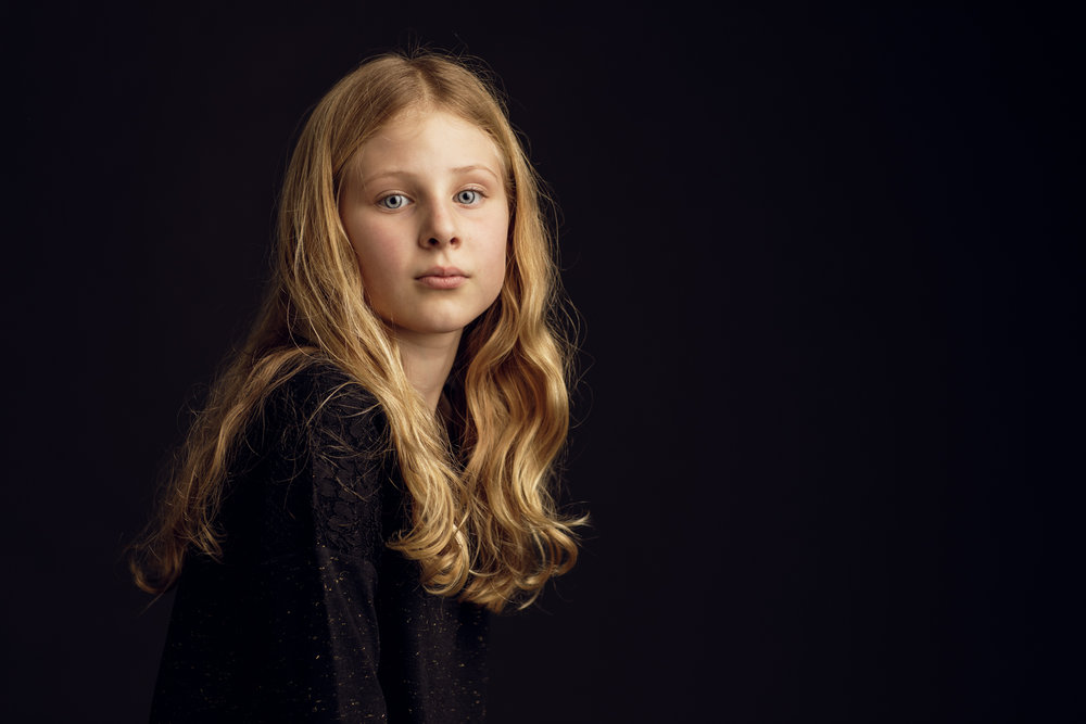 Studio image of girl with blond hair
