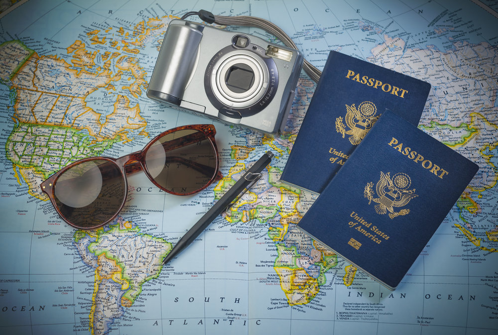 Image of map, passports, camera, and sunglasses