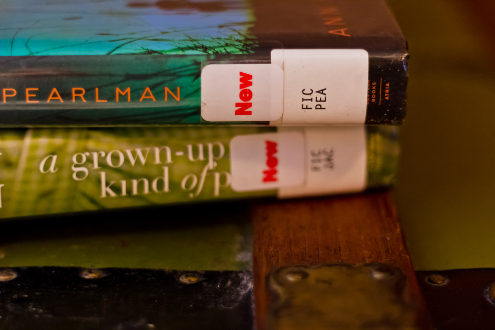 Library books on a bedside table