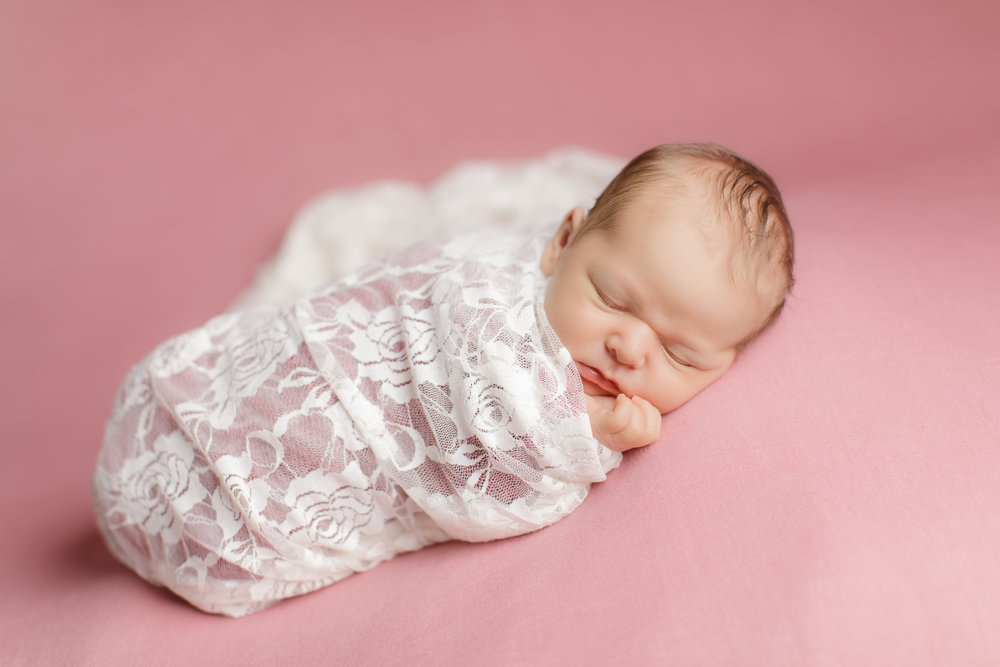 Newborn portrait on pink backdrop in Wakefield, RI