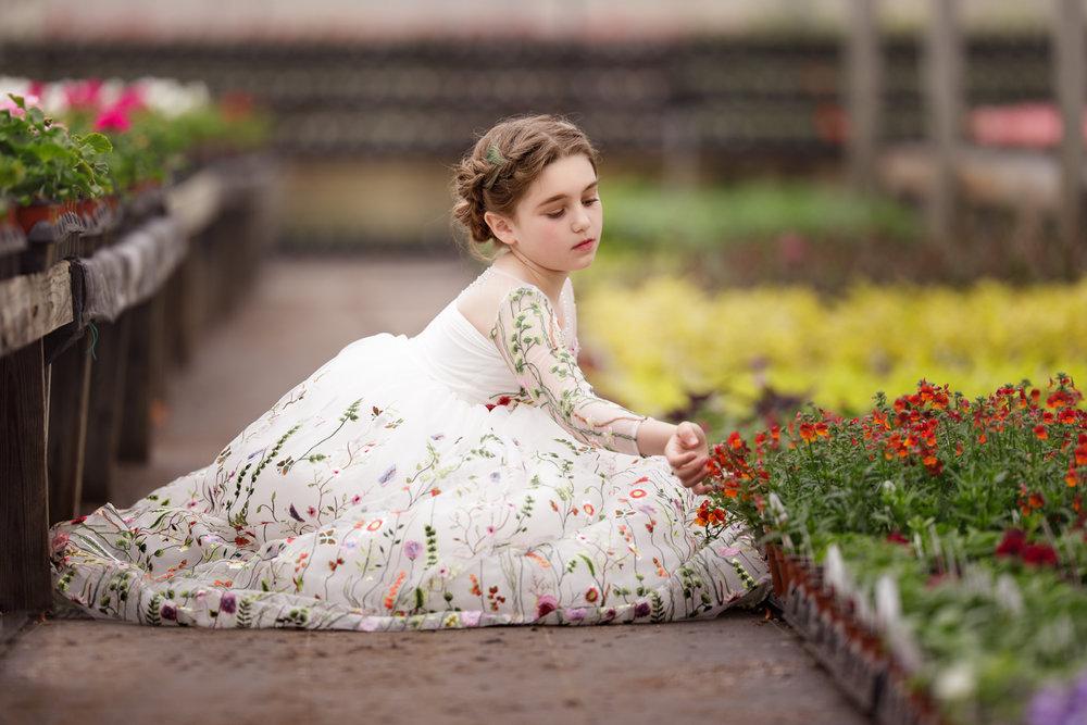 Child in Clark Farms greenhouse in Matunuck, RI