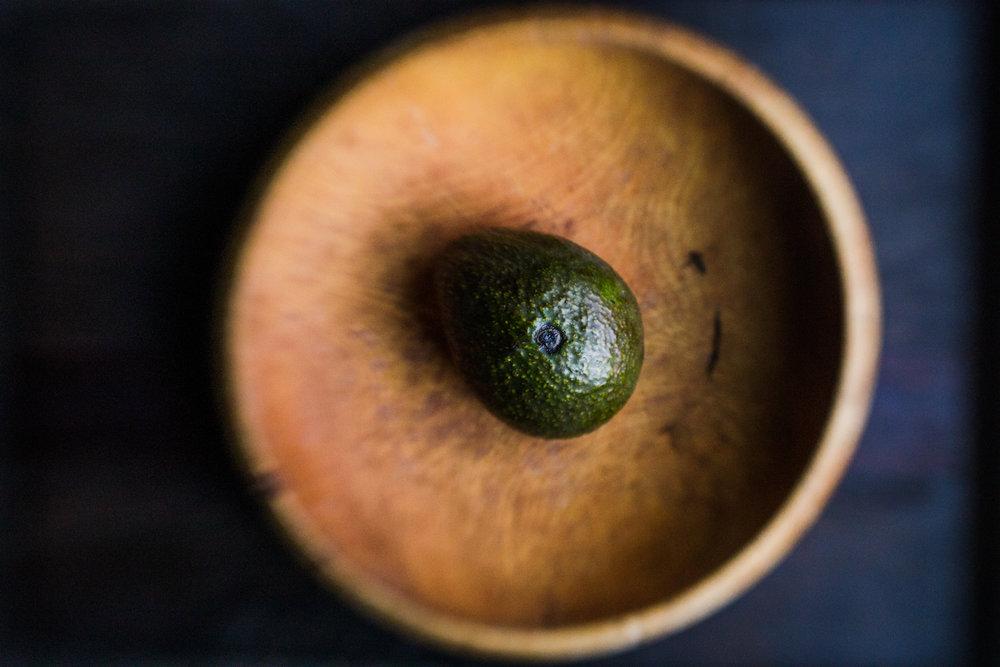 Avocado in a wooden bowl